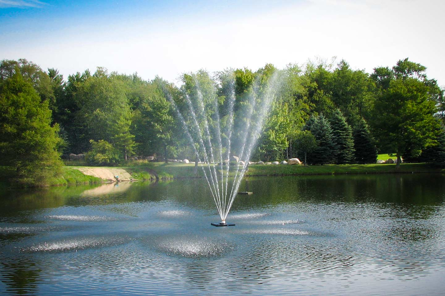 Outdoor water fountains pond water features fountain for Pond with fountain